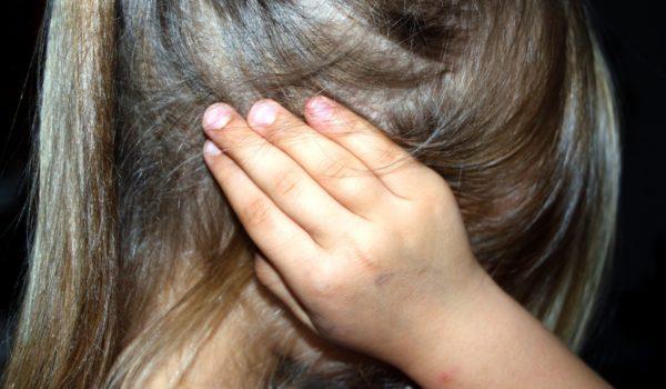 Children covering ears